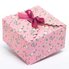 light pink floral gift boxes, flower edge gift boxes, large favor gift boxes, scallop edge gift boxes, favor boxes, gift boxes, pastel gift boxes with ribbons, floral pattern gift boxes, baby shower favor gift boxes, wedding favor gift boxes, teacher's appreciation week gift boxes, gift boxes in bulk | Gift Expressions