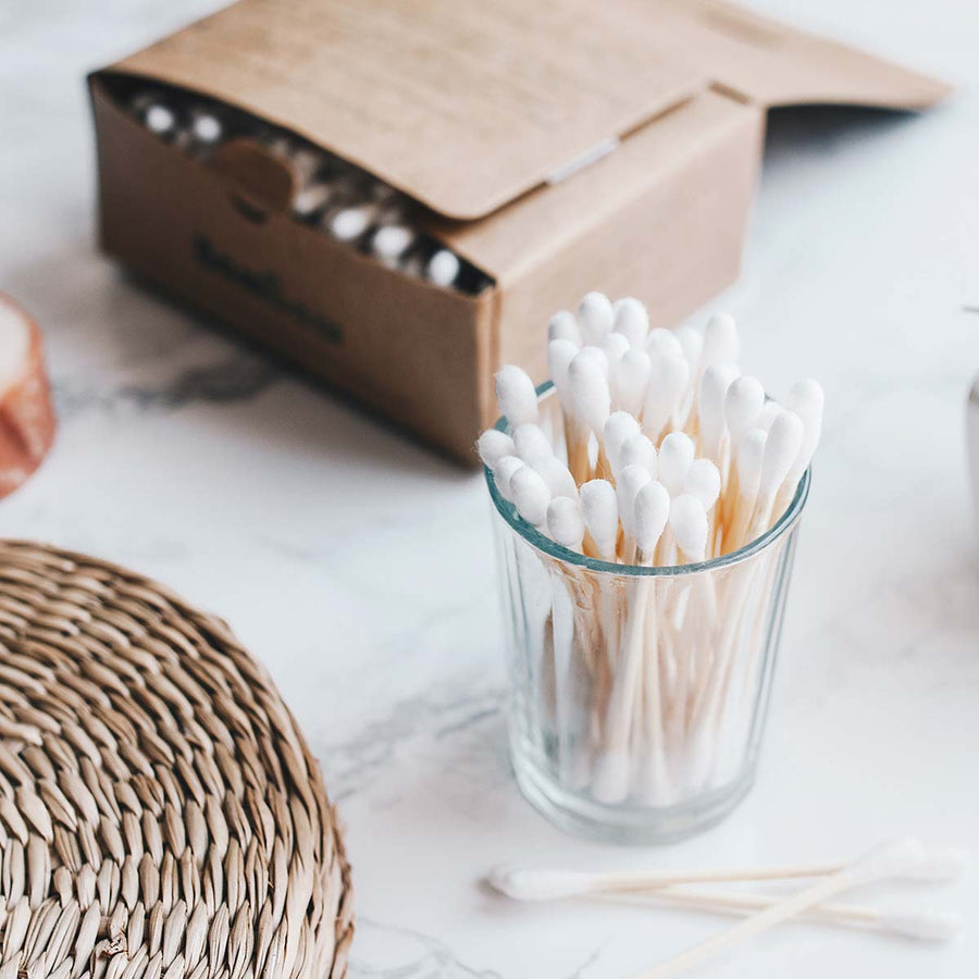 Eco cotton buds in plastic free pacakging and glass.