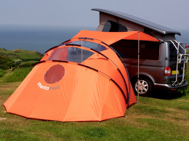 SheltaPod is a vehicle and camper awning that works as a simple sun canopy, a basic shelter or storage space, or a tent for sleeping in. The ideal family tent for camping, whatever the weather.