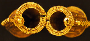 Gold earrings Tamil Nadu, India.