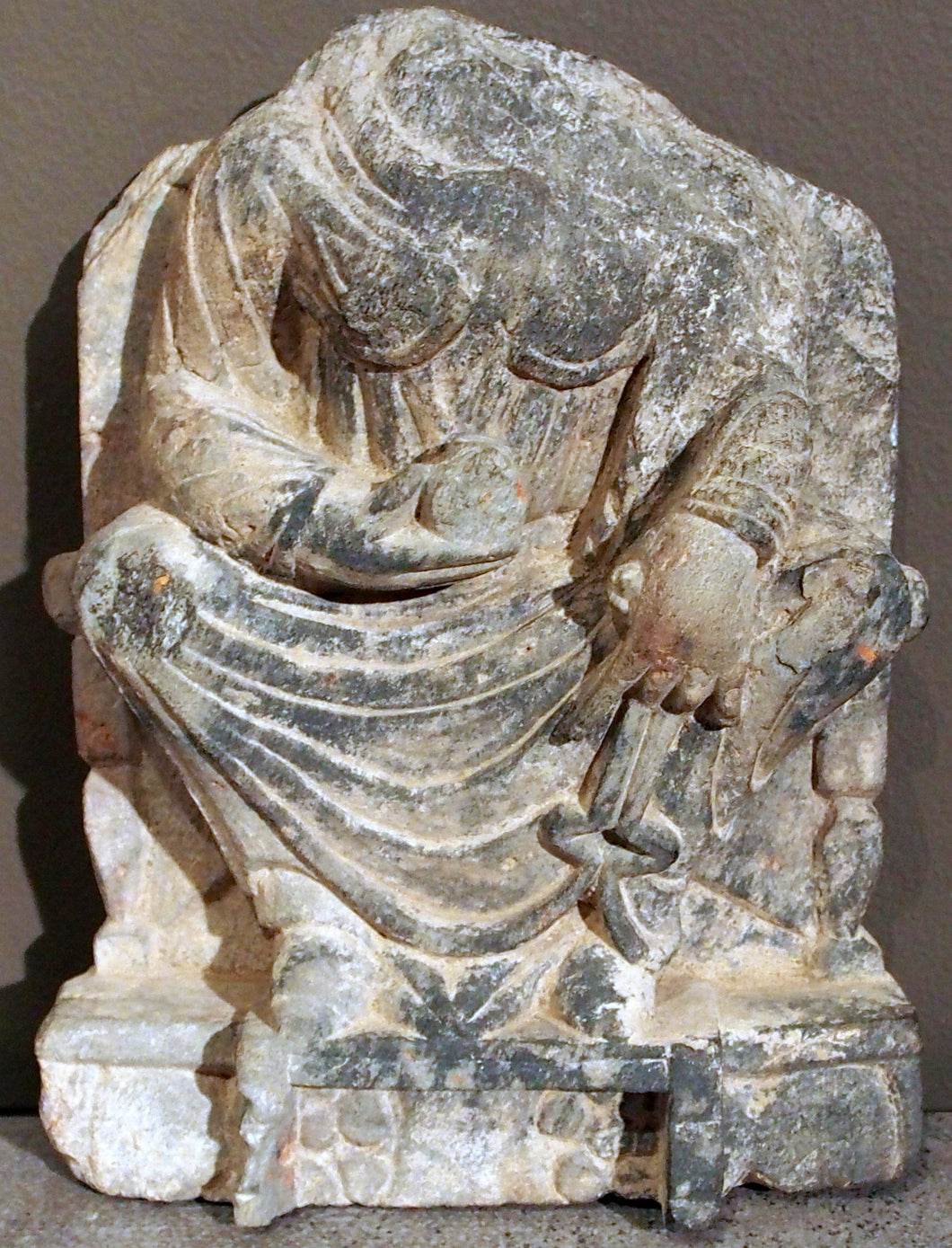 Gandhara acephalic statue of Maitreya, the Buddha of the future