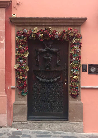 carved_wood_door_hacienda_architecture_casa_san miguel_mexico_pink_stucco