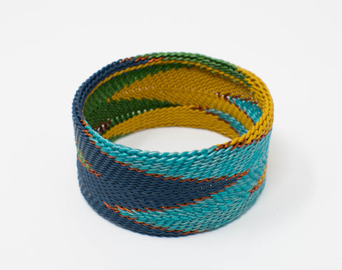 recycled_telephone wire_copper_yellow_blue_aqua_cuff_bracelet_flame_woven_handmade_san miguel_mexico