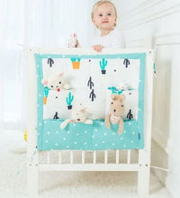 Load image into Gallery viewer, Cotton crib fabric organizer with pockets and ties - bed hanging storage bag for baby cot bed - boo.bootik