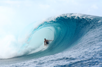 Person surfing a large wave