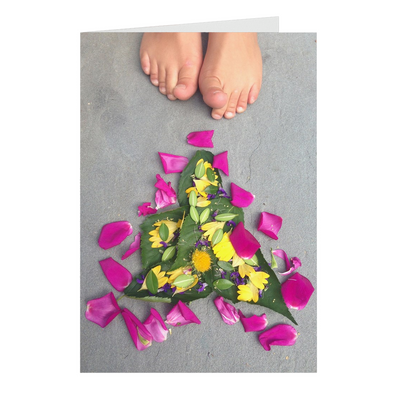 Meghan Nathanson Artistry color photo of child's toes with flower art arrangement on folded greeting card