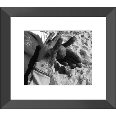 Meghan Nathanson Artistry black and white photo of a child's hands holding a ball of sandy mud 8x10 framed print