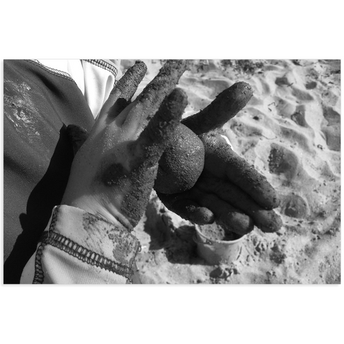 Meghan Nathanson Artistry black and white photo of a child's hands holding a ball of sandy mud on mini canvas print