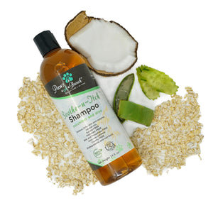 Leaning bottle of Soothe n Itch Dog Shampoo by Paws-a-Bunch with Ingredients around it. Colloidal Oatmeal Dog Shampoo for Dogs and Cats Anti-Itch