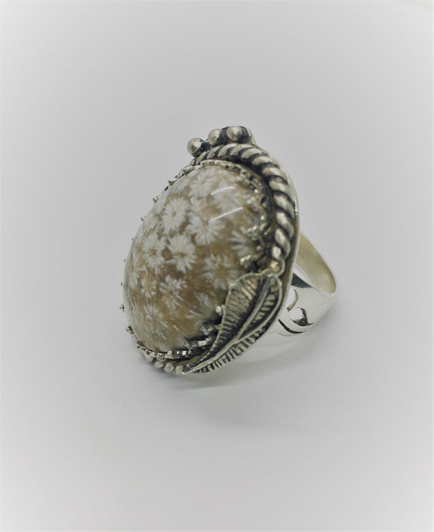 Fossil Coral natural stone set in a sterling silver beaded bezel, with silver feather feature on bezel.  Sterling Silver Fossil Coral Cabochon Stone Size - 8 3/4