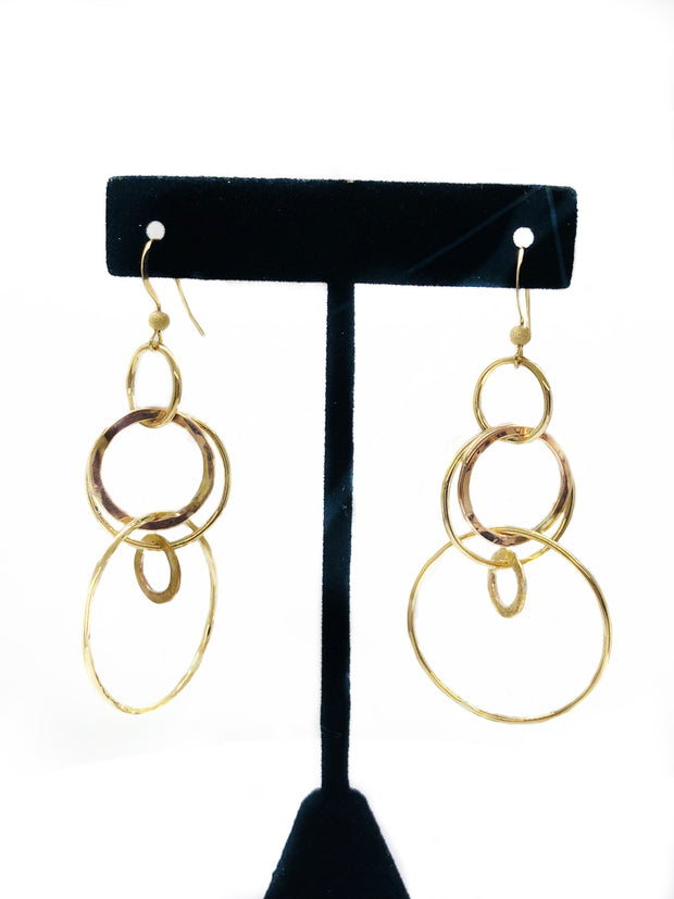 These are perfect for a night out. A mix of five rose gold/yellow gold filled hoops make up the design for these beautiful dangles.