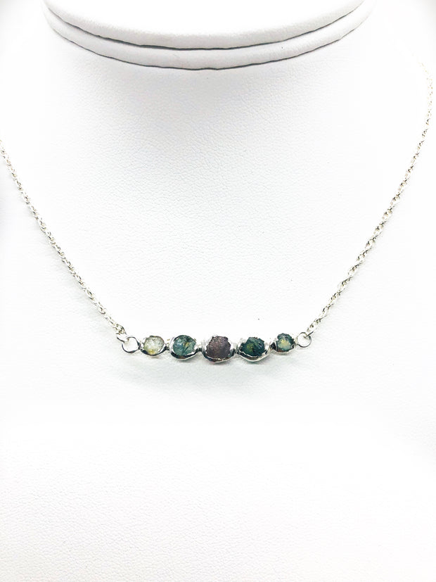 This one of a kind handmade beautiful mix of rough Montana Sapphires make up this unique necklace  Made in  silver with a 18 inch silver chain and lobster clasp.