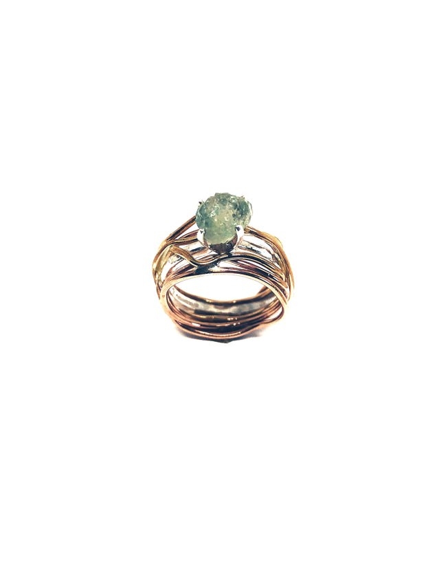 This is a one of a kind unique boho tri-toned wrap ring solitiare. The center stone is a stunning large blue/green rough sapphire measuring 6 x 7.5 mm.  Ring Size - 5 1/2 Top Width - 9.8mm Base Width - 7 mm Material - Sterling Silver, rose and yellow gold filled