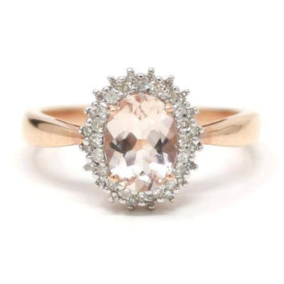 This beautiful Rose Gold ring is set with a sparkling 1.2ct Morganite and surrounded with .18ct of diamonds.  10k Rose Gold 1.2ct Morganite 0.18ct Diamonds Size - 7 1/4