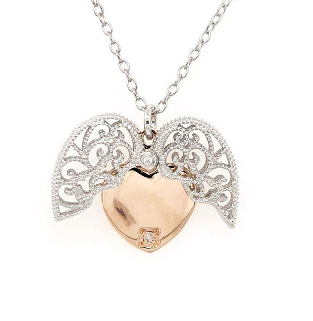 Beautiful Sterling Silver two tone heart pendant with milgrain design outer heart that opens to an engravable inner pink heart set with an accent diamond.