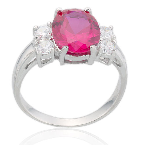 Oval Ruby and Four CZ Ring