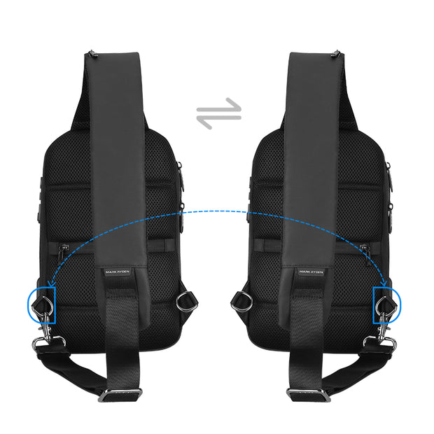 Strap system on Mark Ryden Crypto usb charging waterproof sling bag in black.