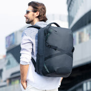 Man wearing Mark Ryden high capacity waterproof USB charging travel backpack - Beyond.