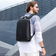 Man with Mark Ryden lightweight and waterproof USB charging backpack - Blend.