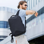 Man wearing Mark Ryden Cache USB Charging backpack in black.