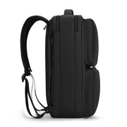 Side view of Mark Ryden minimal black USB charging travel shoulder bag.