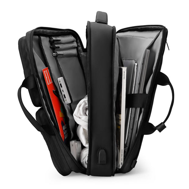 Inside of Mark Ryden minimal black USB charging travel shoulder bag.