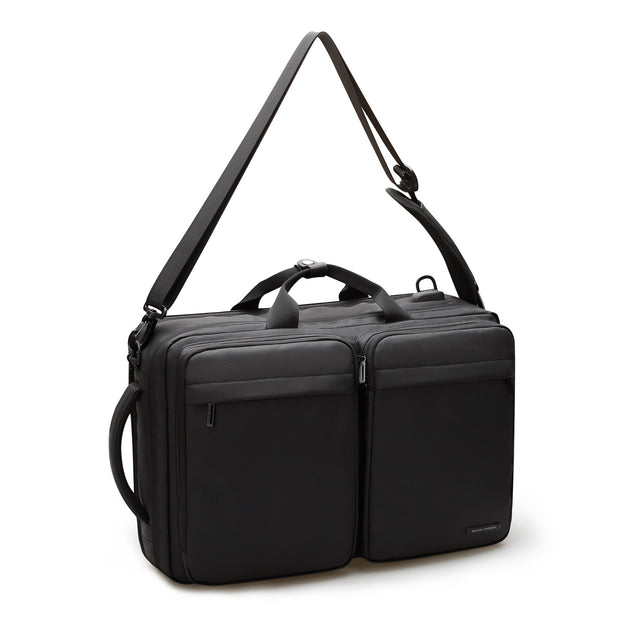 Mark Ryden minimal black USB charging travel shoulder bag with shoulder strap.