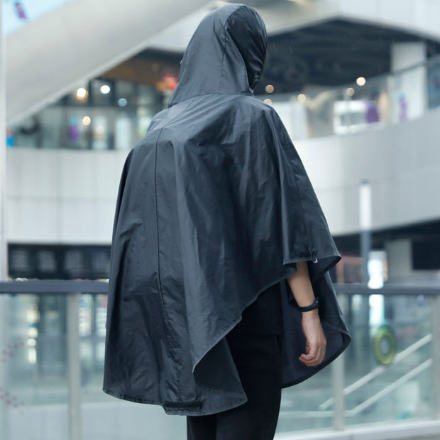 Man wearing Mark Ryden Infinity XL Rain usb charging business / travel backpack with rain cloak.