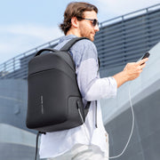 Man wearing Mark Ryden Limit anti-theft usb charging backpack.