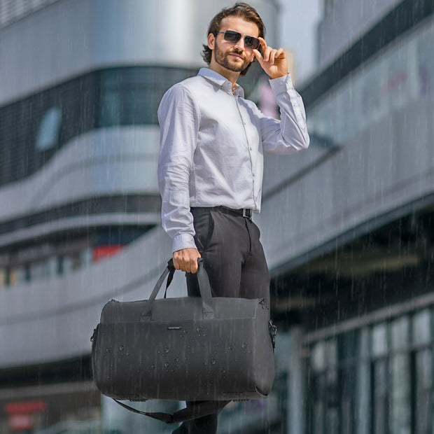 Man with Mark Ryden Marshal waterproof travel bag.