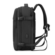 Side  view of Mark Ryden Nomad usb charging travel backpack.