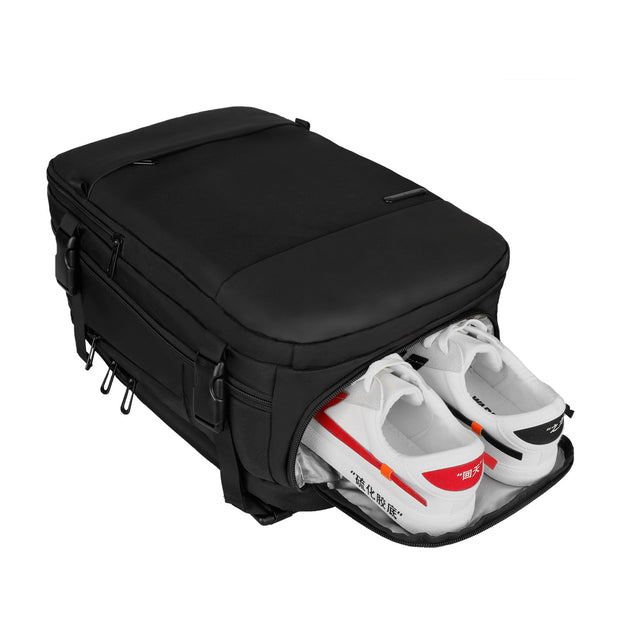 Shoe compartment on Mark Ryden Nomad usb charging travel backpack.