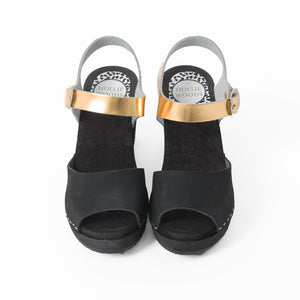 Black and gold sandal with black soles