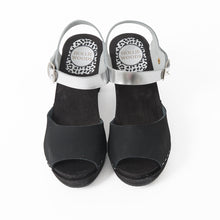 Black and silver sandal with black soles