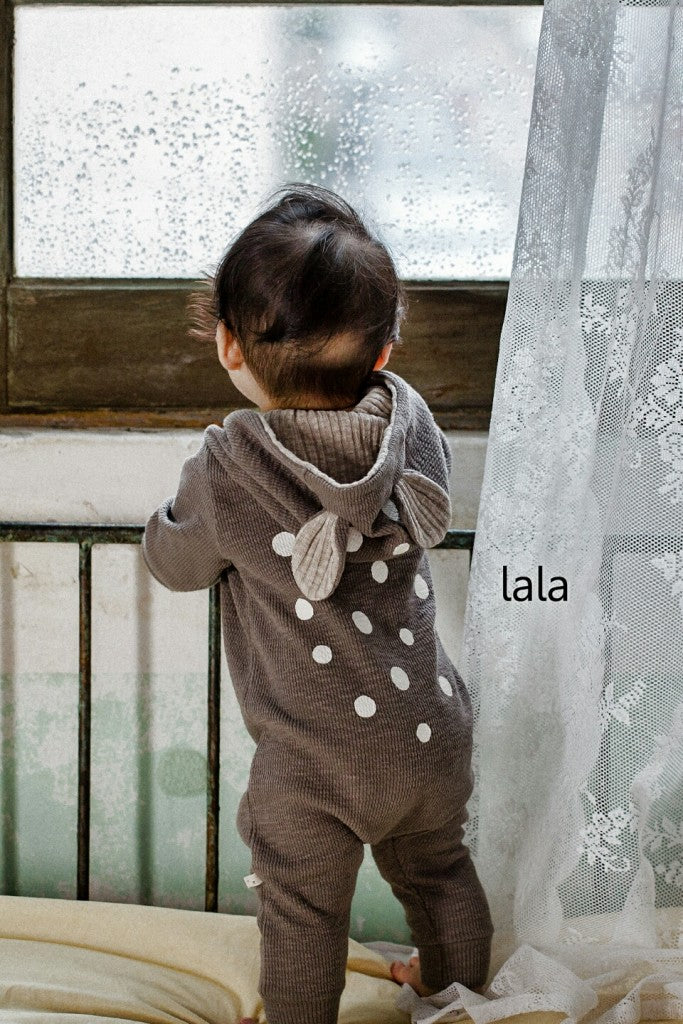 A baby wearing Lala Bambi Romper in grey