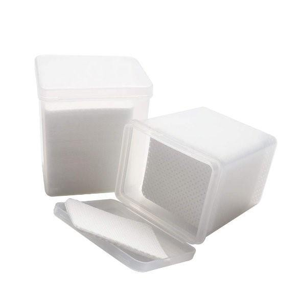 white adhesive wipes for lash glue in a plastic container