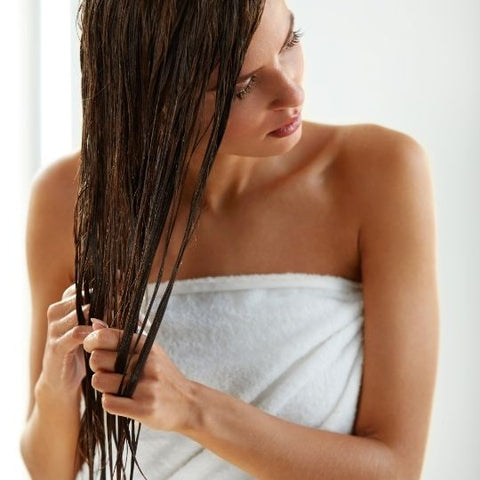 Wash hair with warm water instead of hot