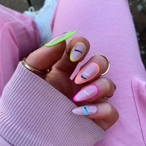 3. Just Do It Logo Almond Nails
