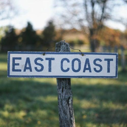 East Coast wood sign on tree