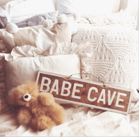 Babe Cave Sign at home - The original creators