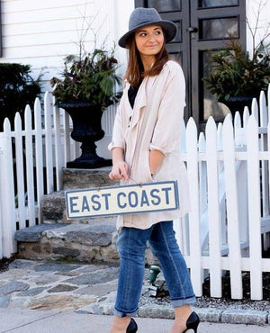 Cute girl holding Weathered Signs East Coast Sign