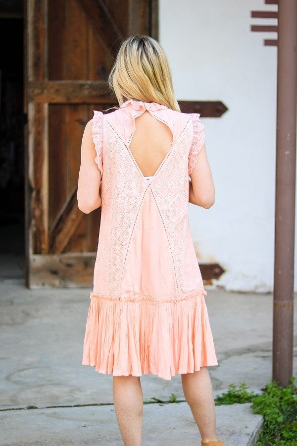 Buy Sleeveless Tunic Dress with High Neckline Peach online at Southern Fashion Boutique Bliss