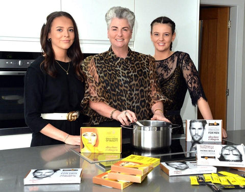 Maxine in the kitchen with her daugthers, Margot and Darcy, and boxes of Absolute Collagen