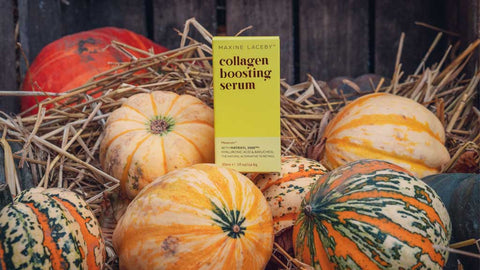 Photo of a yellow box of Absolute Collagen's serum, Maxerum, atop a pile of pumpkins, with hay in the background
