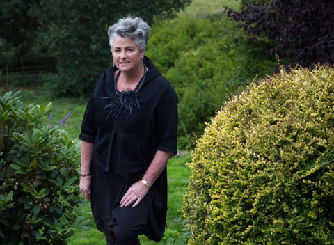 Absolute Collagen founder, Maxine Laceby, standing in garden.