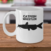 Catfish Wrestler White Ceramic 11oz. Coffee Cup On Table