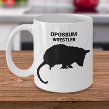 Opossum Wrestler White 11oz. Coffee Cup On Table