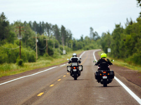 two motorcycle riders on the road