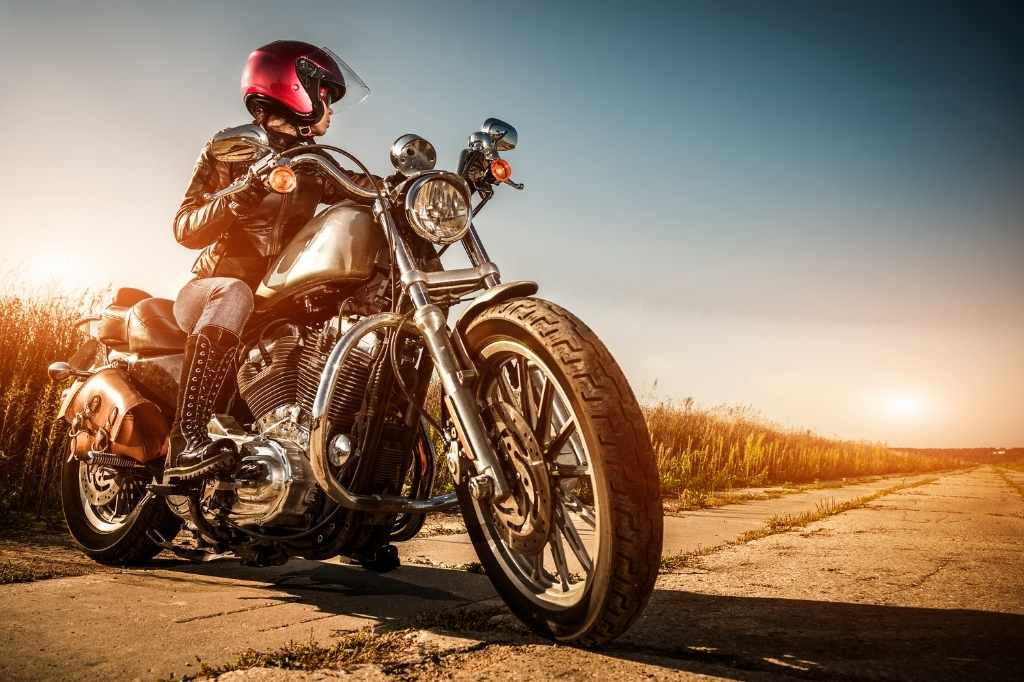 person on motorcycle in sunset scenery