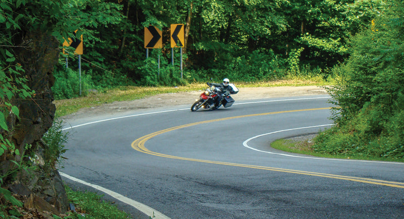 Motorcycle rider cornering on the road